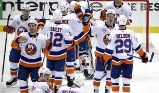 The New York Islanders celebrate at the end of Game 4 of an NHL hockey first-round playoff series against the Pittsburgh Penguins in Pittsburgh, Tuesday, April 16, 2019. The Islanders won 3-1, and swept the series. (AP Photo/Gene J. Puskar)
