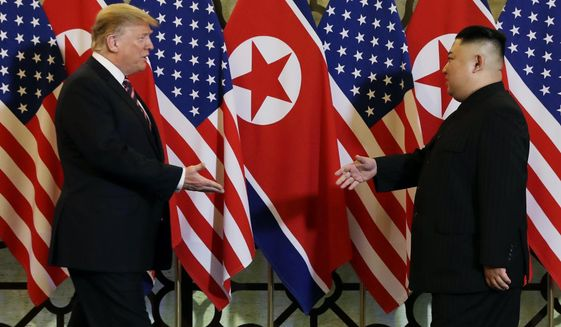 """FILE - In this Feb. 27, 2019, file photo, President Donald Trump meets North Korean leader Kim Jong Un in Hanoi. North Korea has test-fired a """"new-type tactical guided weapon,"""" its state media announced Thursday, April 18, a move that could be an attempt to register the country's displeasure with currently deadlocked nuclear talks with the United States without causing those coveted negotiations to collapse. (AP Photo/ Evan Vucci, File)"""