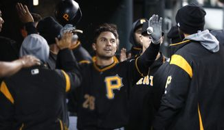 Pittsburgh Pirates' Adam Frazier celebrates scoring on a Colin Moran single in the 10th inning of a baseball game against the Detroit Tigers in Detroit, Wednesday, April 17, 2019. (AP Photo/Paul Sancya)