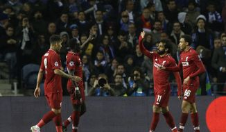 Liverpool's Mohamed Salah, second right, celebrates after scoring his side's second goal during the Champions League quarterfinal, 2nd leg, soccer match between FC Porto and Liverpool at the Dragao stadium in Porto, Portugal, Wednesday, April 17, 2019. (AP Photo/Armando Franca)