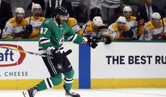 Dallas Stars right wing Alexander Radulov celebrates his goal as players on the Nashville Predators bench watch during the first period of Game 4 in an NHL hockey first-round playoff series in Dallas, Wednesday, April 17, 2019. (AP Photo/Tony Gutierrez)