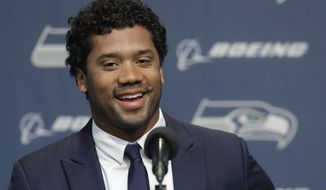 Seattle Seahawks quarterback Russell Wilson talks to reporters Wednesday, April 17, 2019, in Renton, Wash. Earlier in the week, Wilson signed a $140 million, four-year extension with the NFL football team. (AP Photo/Ted S. Warren)