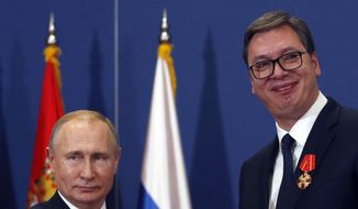 "FILE - In this photo taken Thursday, Jan. 17, 2019, Russian President Vladimir Putin, left, poses with Serbian President Aleksandar Vucic after being awarded the Order of Alexander Nevsky in Belgrade, Serbia. Serbia is seeking an increased Russian role in the European Union-mediated talks with the former province of Kosovo, the move which could further strain the Balkan country's relations with the West. Serbia's Foreign Minister Ivica Dacic said after meeting his Russian counterpart Sergey Lavrov on Wednesday, April 17 in Moscow that ""Serbia cannot defend its state interests without the assistance of the Russian Federation."" (AP Photo/Darko Vojinovic)"