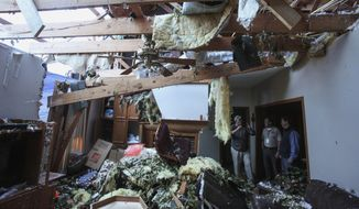 Pat McGuffie speaks with Warren County Sheriff Martin Pace and Lt. Gov. Tate Reeves about the damage at his home in Warren County, Miss., Tuesday, April 16, 2019, following Saturday evening's tornados that swept through Vicksburg and Warren County. (Courtland Wells/The Vicksburg Post via AP)