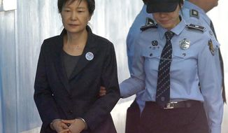 "FILE - In this Oct. 10, 2017, file photo, former South Korean President Park Geun-hye, left, arrives to attend a hearing on the extension of her detention at the Seoul Central District Court in Seoul, South Korea. Prosecutors on Wednesday, April 17, 2019, said imprisoned Park requested a temporarily release so she can be treated for health problems her lawyer says are causing ""burning"" and ""cutting"" pain. (AP Photo/Ahn Young-joon, File)"