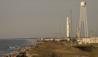 This photo provided by NASA shows the Northrop Grumman Antares rocket, with Cygnus resupply spacecraft onboard  on Pad-0A, Wednesday, April 17, 2019 at NASA's Wallops Flight Facility in Virginia. The cargo resupply mission for NASA to the International Space Station will deliver about 7,600 pounds of science and research, crew supplies and vehicle hardware to the orbital laboratory and its crew. (Bill Ingalls/NASA via AP)