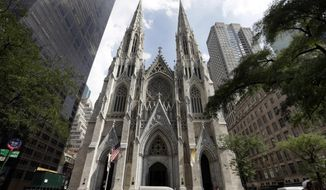 This Sept. 6, 2018, photo shows St. Patrick's Cathedral in New York. A New Jersey man has been arrested outside the cathedral with two jugs of gasoline. Police say church personnel stopped the 37-year-old man from entering the landmark cathedral in Manhattan at about 9 p.m. Wednesday, April 17, 2019. Authorities were investigating whether the unidentified man is emotionally disturbed. (AP Photo/Richard Drew)
