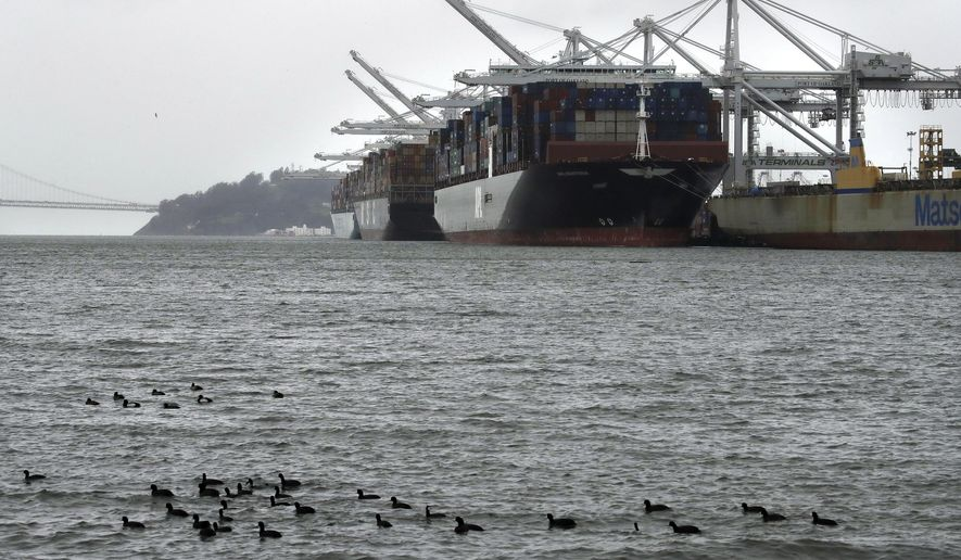 FILE - In this March 6, 2019, file photo, container ships docked at the Port of Oakland wait to be unloaded in Oakland, Calif. On Wednesday, April 17, the Commerce Department reports on the U.S. trade gap for February. (AP Photo/Ben Margot, File)