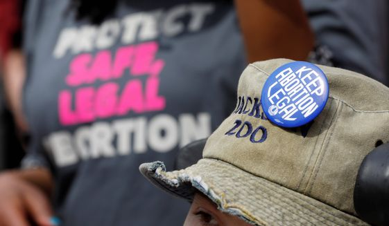 Pro-choice advocates asked the high court to strike down a law that mandates that clinics have admitting privileges to hospitals should complications from an abortion arise. (Associated Press)