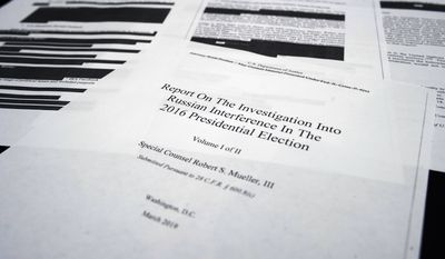 Four pages of special counsel Robert Mueller report on the witness table in the House Intelligence Committee hearing room on Capitol Hill, in Washington, Thursday, April 18, 2019.. (AP Photo/Cliff Owen) ** FILE **