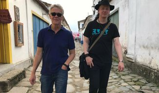 "This photo courtesy of Dag Gustafsson, taken by his wife Görel Bini Gustafsson, shows Dag with his son Ola Bini in Paraty, Brazil on May 28, 2017. Bini, a privacy activist who was detained in Ecuador shortly after Julian Assange was arrested in London, said in a statement provided by his attorney that he's being held under ""the best of circumstances"" but that prison conditions are ""despicable."" Ecuadorian President Lenin Moreno claims Bini hacked cellphones and online accounts belonging to private citizens and Ecuador's government. (Dag Gustafsson via AP)"