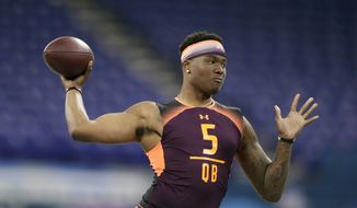 In this March 2, 2019, file photo, Ohio State quarterback Dwayne Haskins runs a drill at the NFL football scouting combine, in Indianapolis. Haskins is a possible pick in the 2019 NFL Draft. (AP Photo/Michael Conroy, File) **FILE**
