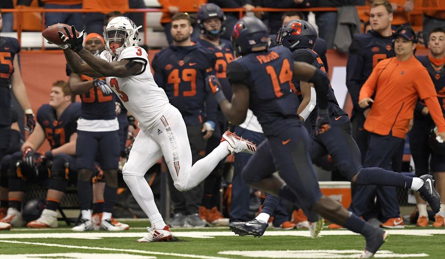 In this Oct. 27, 2018, file photo, North Carolina State wide receiver Kelvin Harmon (3) makes a catch along the sideline during the second half of an NCAA college football game against Syracuse, in Syracuse, N.Y. Harmon is a possible pick in the 2019 NFL Draft. (AP Photo/Adrian Kraus, File)