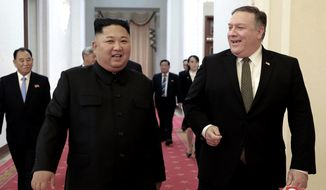 """FILE - In this Oct. 7, 2018, file photo provided by the North Korean government, North Korean leader Kim Jong Un, center left, and U.S. Secretary of State Mike Pompeo walk together before their meeting in Pyongyang, North Korea. North Korea said Thursday, April 18, 2019, that it had test-fired a new type of """"tactical guided weapon,"""" its first such test in nearly half a year, and demanded that Washington remove Pompeo from nuclear negotiations. Korean language watermark on image as provided by source reads: """"KCNA"""" which is the abbreviation for Korean Central News Agency. (Korean Central News Agency/Korea News Service via AP, File)"""