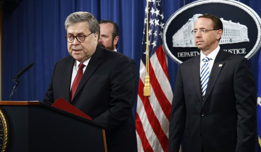 Attorney General William Barr speaks alongside Deputy Attorney General Rod Rosenstein, right, and Deputy Attorney General Ed O'Callaghan, rear left, about the release of a redacted version of special counsel Robert Mueller's report during a news conference, Thursday, April 18, 2019, at the Department of Justice in Washington. (AP Photo/Patrick Semansky)