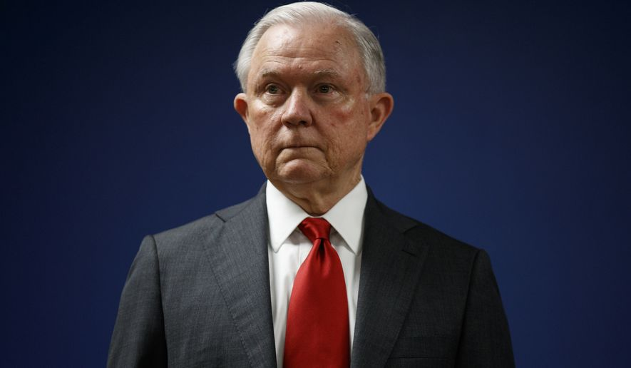 FILE - In this Oct. 15, 2018, file photo, Attorney General Jeff Sessions pauses during a news conference at the U.S. Attorney's Office for the District of Columbia in Washington. (AP Photo/Carolyn Kaster, File)