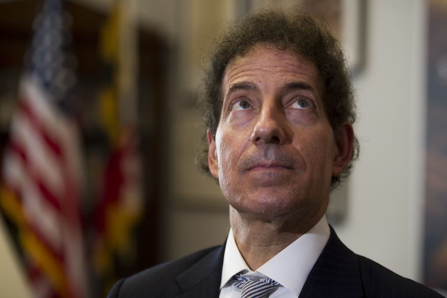 House Judiciary Committee member Rep. Jamie Raskin, D-Md., watches Committee Chairman Jerry Nadler, D-N.Y. speak at a news conference about the Mueller Report on the television in his Capitol Hill office, in Washington, Thursday, April 18, 2019. (AP Photo/Cliff Owen)