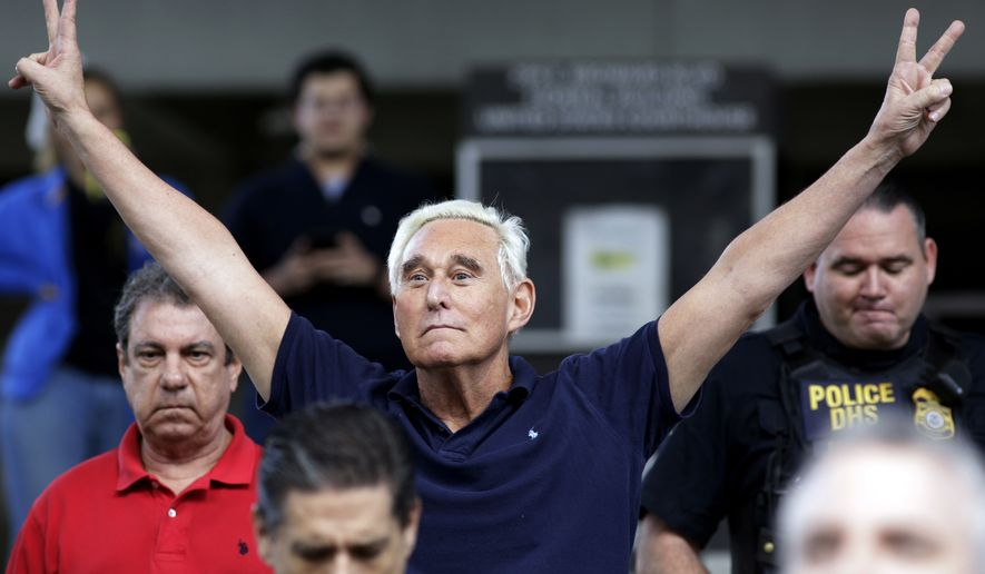 In this Jan. 25, 2019, file photo, former campaign adviser for President Donald Trump, Roger Stone walks out of the federal courthouse following a hearing in Fort Lauderdale, Fla. (AP Photo/Lynne Sladky, File)