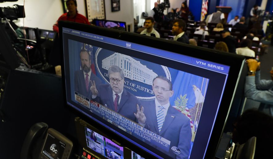 Journalists in the press room in the West Wing of the White House watch the televised broadcast of Attorney General William Barr speaking alongside Deputy Attorney General Rod Rosenstein, right, and Deputy Attorney General Ed O'Callaghan, left, about the release of a redacted version of special counsel Robert Mueller's report April 18, 2019, Thursday, April 18, 2019, in Washington. (AP Photo/Pablo Martinez Monsivais)