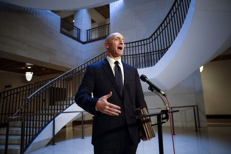FILE - In a Nov. 2, 2017, file photo, Carter Page, a foreign policy adviser to Donald Trump's 2016 presidential campaign, speaks with reporters following a day of questions from the House Intelligence Committee, on Capitol Hill in Washington. (AP Photo/J. Scott Applewhite, File)