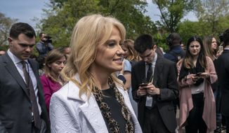 Counselor to the President Kellyanne Conway smiles as she returns to the West Wing after responding to reporters about President Donald Trump's reaction to the release of a redacted version of special counsel Robert Mueller's investigation into Russian interference in the 2016 U.S. election, at the White House in Washington, Thursday, April 18, 2019. (AP Photo/J. Scott Applewhite)