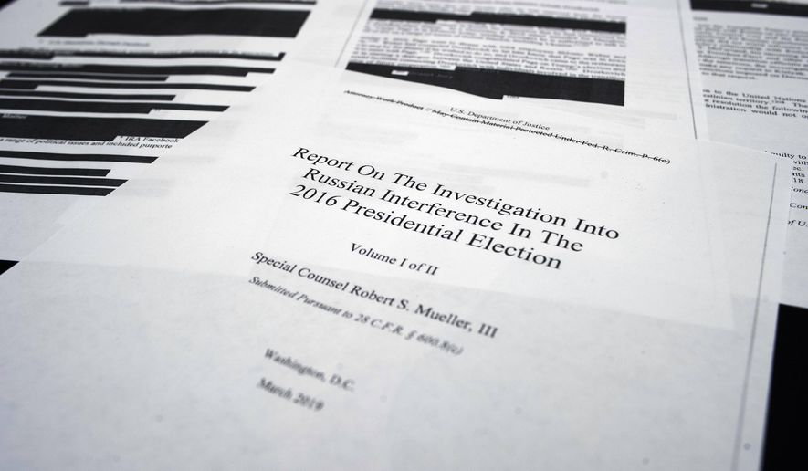 Four pages of special counsel Robert Mueller report on the witness table in the House Intelligence Committee hearing room on Capitol Hill, in Washington, Thursday, April 18, 2019.. (AP Photo/Cliff Owen)
