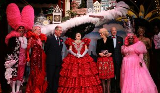 "File - In this Nov. 6, 2005, file photo, Prince Charles, third from left, and his wife, Camilla, Duchess of Cornwall, fifth from left, meet Val Diamond, center, wearing a San Francisco Skyline Hat and other cast members after they attended the musical performance of Beach Blanket Babylon in San Francisco. Next to the Duchess of Cornwall is former U.S. Secretary of State George Shultz, and beside Prince Charles is Charlotte Maillard Shultz. The campy ""Beach Blanket Babylon"" musical revue show that has been a must-see for San Francisco tourists for 45 years is coming to an end. Producer Jo Schuman Silver announced Wednesday, April 17, 2019, the show's final performances will be on New Year's Eve. (AP Photo/Paul Sakuma, Pool, File)"
