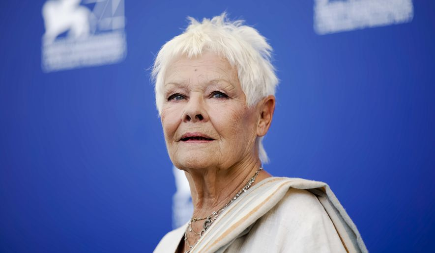 """FILE - In this Sunday, Sept. 3, 2017 file photo, actress Judi Dench poses during a photo call for the film """"Victoria And Abdul"""" at the 74th Venice Film Festival in Venice, Italy. Judi Dench is back in the world of espionage _ but her latest role is a far cry from James Bond's unflappable spy chief, M. In """"Red Joan,"""" released in Britain and the U.S. on Friday, April 19, 2019, Dench plays an elderly British woman whose quiet suburban life is upended when police come knocking, accusing her of passing nuclear secrets to the Soviet Union during the Cold War. (AP Photo/Domenico Stinellis, file)"""