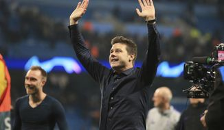 Tottenham coach Mauricio Pochettino waves to the fans during the Champions League quarterfinal, second leg, soccer match between Manchester City and Tottenham Hotspur at the Etihad Stadium in Manchester, England, Wednesday, April 17, 2019. (AP Photo/Jon Super)