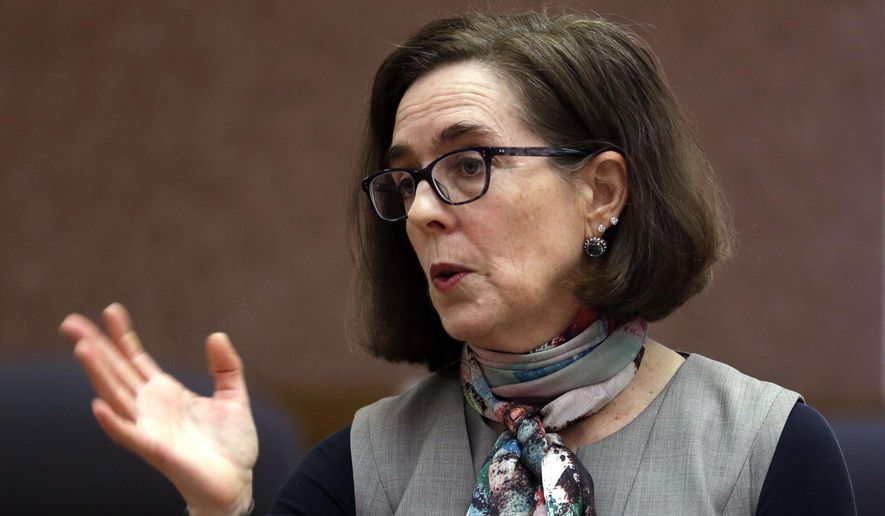 In this Thursday, Jan. 26, 2017, file photo, Oregon Gov. Kate Brown speaks to media representatives in Salem, Ore.  (AP Photo/Don Ryan, File) ** FILE **