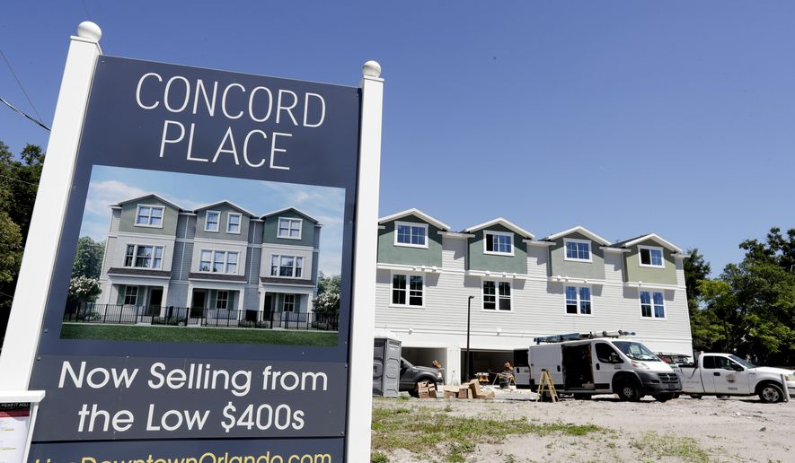 In this Tuesday, April 16, 2019, photo, new town homes under construction are being built in vacant lots in a neighborhood near downtown Orlando, Fla. The U.S. Census Bureau said Thursday, April 18 that Orlando grew by 60,000 people from mid-2017 to mid-2018, making it the fifth biggest metro increase in pure numbers in the nation. (AP Photo/John Raoux)