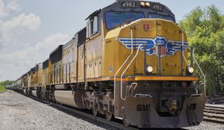 FILE- In this July 31, 2018, file photo a Union Pacific train travels through Union, Neb. Union Pacific Corp. reports earnings Thursday, April 18, 2019. (AP Photo/Nati Harnik, File)
