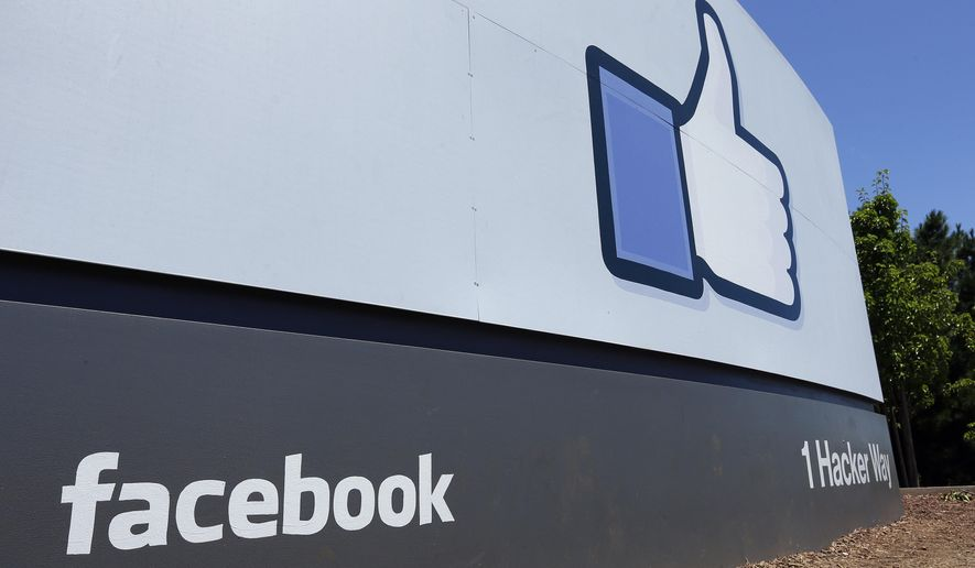 This July 16, 2013 file photo shows a sign at Facebook headquarters in Menlo Park, Calif. (AP Photo/Ben Margot, File)