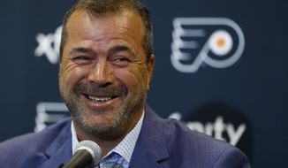 Alain Vigneault, newly hired Philadelphia Flyers head coach, smiles while speaking to the media during an introductory press conference at the Flyer's NHL hockey practice facility, Thursday, April 18, 2019, in Voorhees, N.J. (AP Photo/Matt Slocum)
