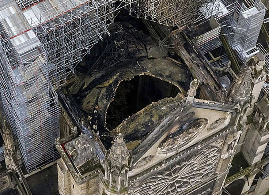 An image made available by Gigarama.ru on Wednesday April 17, 2019 shows an aerial shot of the fire damage to Notre Dame cathedral in Paris on Tuesday April 16. Nearly $1 billion has already poured in from ordinary worshippers and high-powered magnates around the world to restore Notre Dame Cathedral in Paris after it was damaged in a massive fire on Monday. (Gigarama.ru via AP)