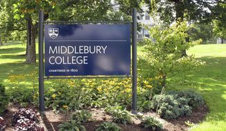 FILE - This Aug. 31, 2017, file photo, shows a sign for Middlebury College on the campus in Middlebury, Vt. A Middlebury College chemistry professor whose written exam question asked students to calculate the lethal dose of a poisonous gas used in Nazi gas chambers during the Holocaust has taken a leave of absence, the school said. (AP Photo/Wilson Ring, File)