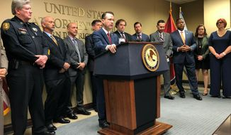 U.S. Attorney for the Western District of Tennessee Michael Dunavant (at podium) speaks at a news conference discussing charges of illegally distributing opioids and other prescription painkillers filed against more than 30 medical professionals in Tennessee on Thursday, April 18, 2019 in Memphis, Tenn. (AP Photo/Adrian Sainz)