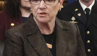 FILE - In this Wednesday, April 17, 2019 file photo, Kansas Gov. Laura Kelly speaks during a news conference at the Statehouse in Topeka, Kansas. The Democratic governor is urging the Republican-controlled Legislature to remain cautious in the wake of a new, slightly more optimistic forecast for state tax collections. (AP Photo/John Hanna)