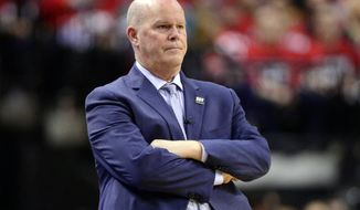Orlando Magic head coach Steve Clifford watches as his team plays the Toronto Raptors during the second half in Game 1 of a first-round NBA basketball playoff series in Toronto, Saturday, April 13, 2019. (Frank Gunn/The Canadian Press via AP)