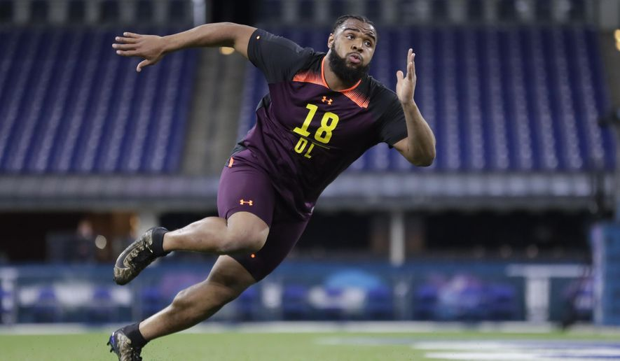 FILE - In this March 3, 2019, file photo, Clemson defensive lineman Christian Wilkins runs a drill at the NFL football scouting combine in Indianapolis. Wilkins is a possible pick in the 2019 NFL Draft. (AP Photo/Michael Conroy, File)