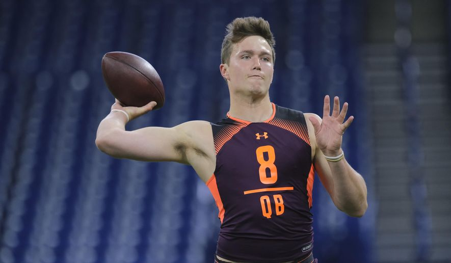 FILE - In this Feb. 28, 2019, file photo, Missouri quarterback Drew Lock throws at the NFL football scouting combine in Indianapolis. Lock is a possible pick in the 2019 NFL Draft. (AP Photo/AJ Mast, File)
