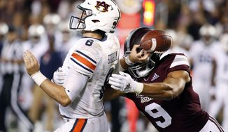 FILE - In this Oct. 6, 2018, file photo, Mississippi State defensive end Montez Sweat (9) forces Auburn quarterback Jarrett Stidham (8) to fumble as he attempts to pass during the second half of an NCAA college football game in Starkville, Miss. Sweat is a possible pick in the 2019 NFL Draft.  (AP Photo/Rogelio V. Solis, File)