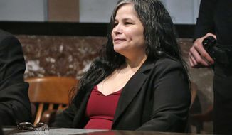 FILE - In this Jan. 11, 2018, file photo, Juanita Gomez is seated at the defense table in Oklahoma County District Court in Oklahoma City, Okla. before being found guilty of first-degree murder in the 2016 death of her 33-year-old daughter Geneva Gomez. The Oklahoma Court of Criminal Appeals has affirmed Thursday, April 18, 2019, the life sentence for Gomez, convicted of killing her daughter by forcing a crucifix and medallion down her throat because she believed the woman was possessed by the devil. (Steve Sisney/The Oklahoman via AP, File)