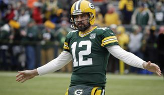 FILE - In this Dec. 30, 2018, file photo, Green Bay Packers' Aaron Rodgers warms up before an NFL football game against the Detroit Lions, in Green Bay, Wis. The Packers have needed the draft for fixes on defense the last few years, but this might be the time for them to swing back to the other side of the ball after a lackluster performance in 2018 by the offense and to give quarterback Aaron Rodgers more help. (AP Photo/Mike Roemer, File)