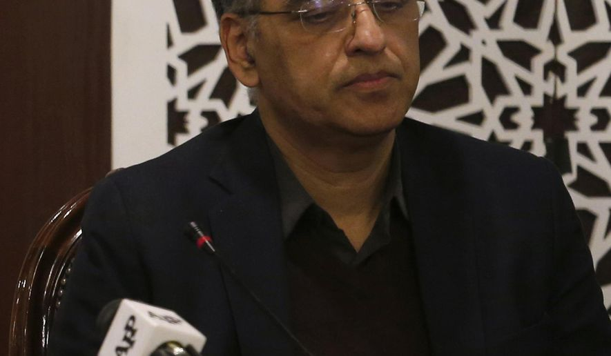 """FILE - In this Tuesday, Feb. 26, 2019 file photo, Pakistan's Finance Minister Asad Umar attend a meeting in Islamabad, Pakistan. Pakistan's finance minister says he will step down amid a wave of criticism over the government's handling of a financial crisis that has sent prices soaring. Umar tweeted Thursday, April 18, 2019 that Prime Minister Imran Khan offered him the energy portfolio in the Cabinet but he refused. He defended Khan's leadership, calling him the """"best hope"""" for Pakistan.(AP Photo/Anjum Naveed, File)"""