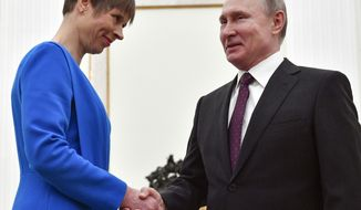 Russian President Vladimir Putin, right, shakes hands Estonia's President Kersti Kaljulaid at the Kremlin in Moscow, Russia, Thursday, April 18, 2019.Thursday's meeting between the presidents of Russia and Estonia is the first one for the leaders of the two neighbouring countries for nearly a decade. (Alexander Nemenov/Pool Photo via AP)