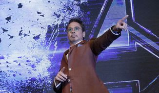 "Actor Robert Downey Jr. poses during an Asia Press Conference to promote his latest film ""Avengers Endgame"" in Seoul, South Korea, Monday, April 15, 2019. The movie will open on April 24 in South Korea. (AP Photo/Ahn Young-joon) ** FILE **"