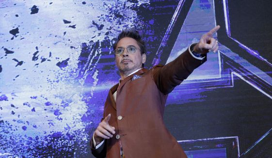 """Actor Robert Downey Jr. poses during an Asia Press Conference to promote his latest film """"Avengers Endgame"""" in Seoul, South Korea, Monday, April 15, 2019. The movie will open on April 24 in South Korea. (AP Photo/Ahn Young-joon) ** FILE **"""