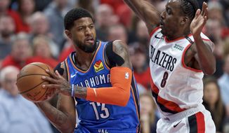Oklahoma City Thunder forward Paul George, left, looks to pass the ball around Portland Trail Blazers forward Al-Farouq Aminu during the first half of Game 2 of an NBA basketball first-round playoff series Tuesday, April 16, 2019, in Portland, Ore. (AP Photo/Craig Mitchelldyer)
