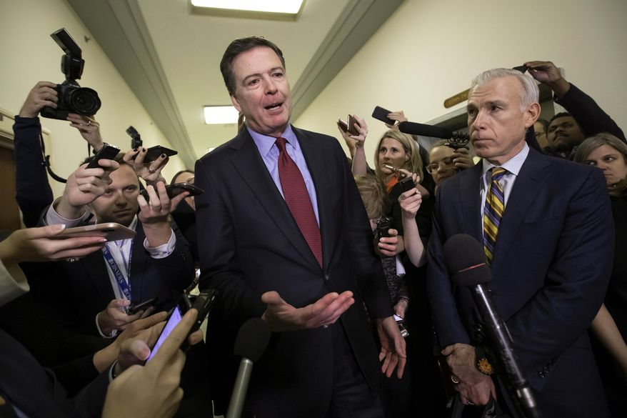 Former FBI Director James Comey speaks to reporters after a day of testimony before the House Judiciary and Oversight committees, on Capitol Hill in Washington. (AP Photo/J. Scott Applewhite, File)